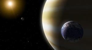 Impresja artystyczna – egzoksiężyc przypominający Ziemię orbituje wokół wielkiej gazowej planety. Credit: NASA/JPL-Caltech