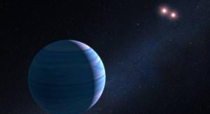 Artystyczna wizualizacja planety gazowego olbrzyma krążącego wokół pary czerwonych karłów w układzie OGLE-2007-BLG-349. Fot. NASA, ESA, and G. Bacon (STScI)