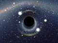 Symulowany widok czarnej dziury umieszczonej przed Wielkim Obłokiem Magellana. By User:Alain r (Own work) [CC BY-SA 2.5 (http://creativecommons.org/licenses/by-sa/2.5)], via Wikimedia Commons