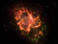 Mgławica Kraba - obraz z nałożonymi na siebie trzema typami promieniowania. Składa się ze światła podczerwonego (czerwone na zdjęciu), światła widzialnego (zielone) i ultrafioletowego (fioletowe). Foto: J. Graves.